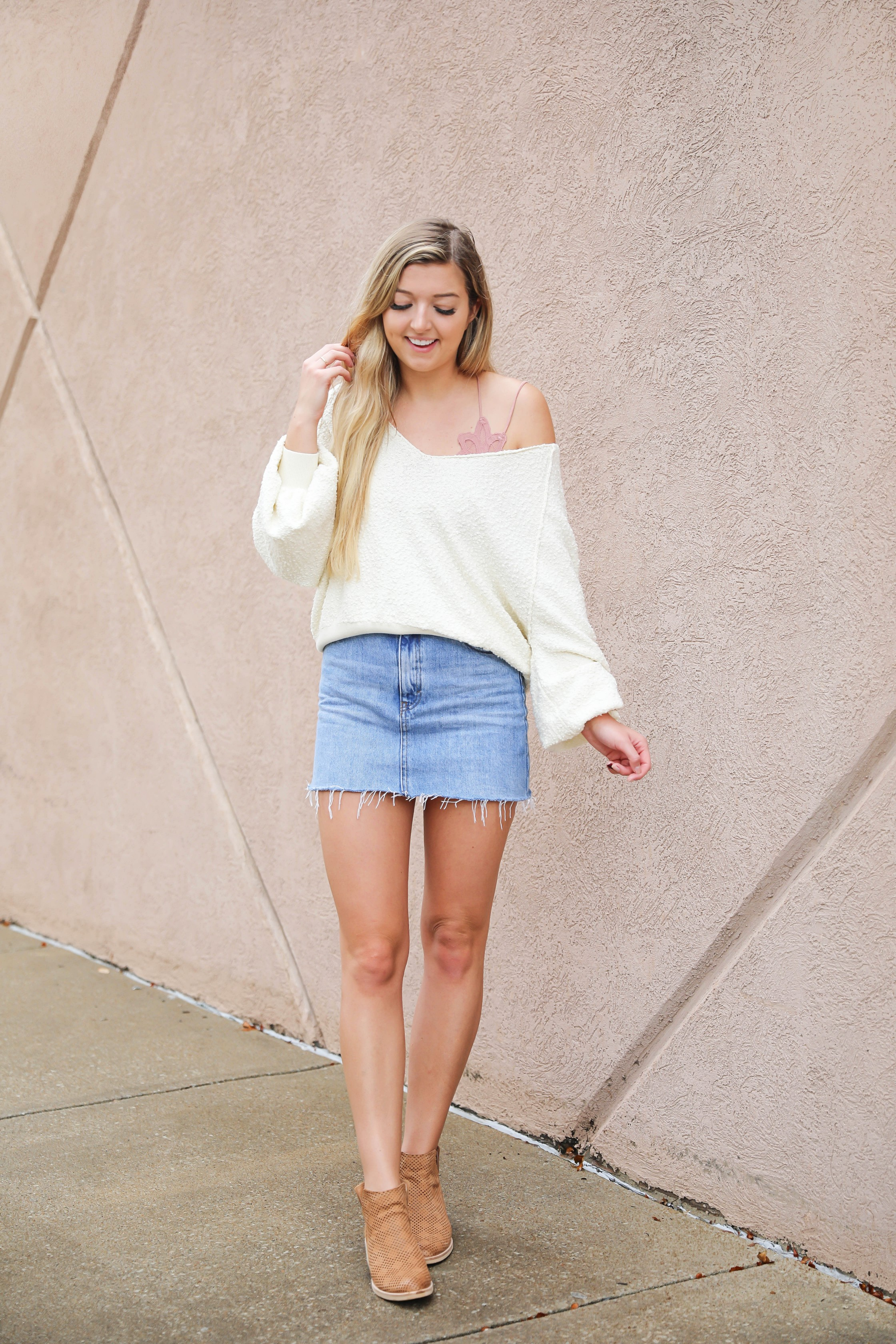 Slouchy Free People sweater that comes in cream, light blue, red, black, yellow, and pink! Paired with a Free People bralette that comes in a ton more colors! I finished this look with a cute denim jean skirt and booties from the nordstrom sale! Details on fashion blog daily dose of charm by lauren lindmark