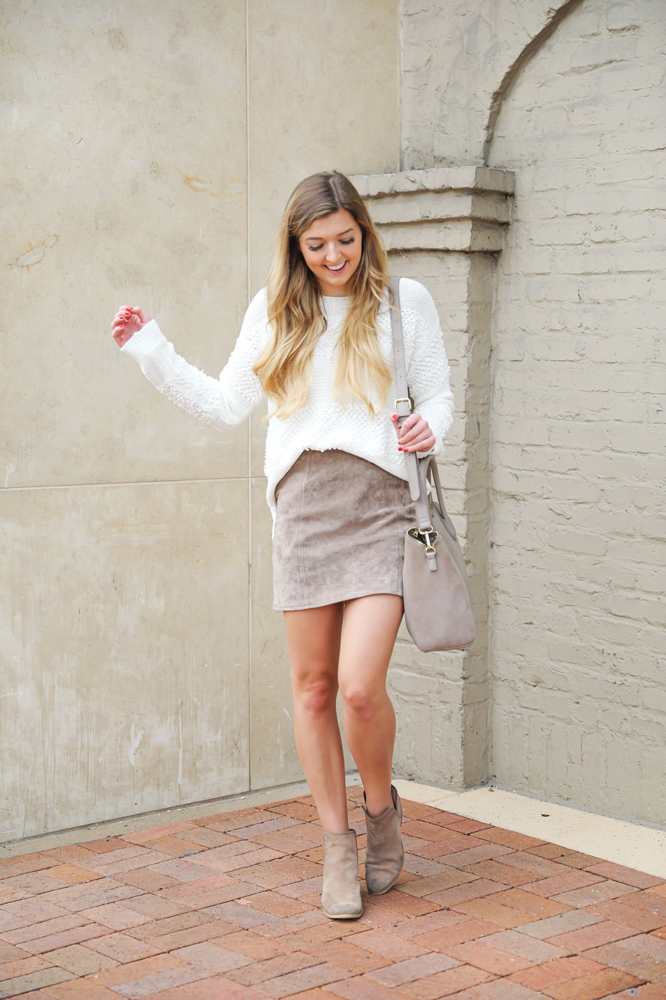 Suede skirt paired with a cream texturized sweater and tan booties! The cutest fall outfit idea! I love autumn outfit inspiration! Details on fashion blog daily dose of charm by lauren lindmark