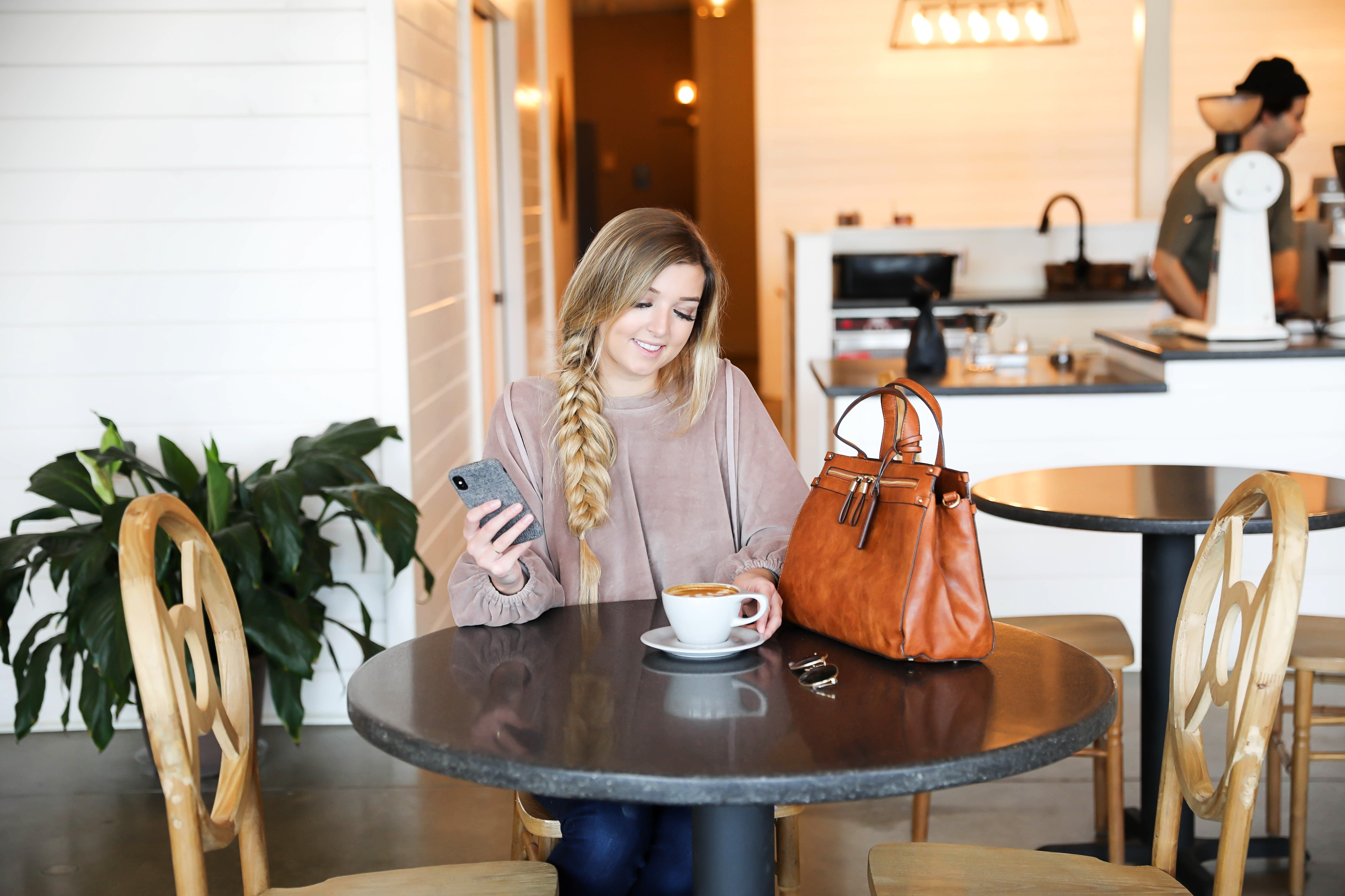 How I boosted my Instagram Engagement by 50%! My tips and tricks for growing an authentic following on Instagram and boosting your likes! Coffee shop date photoshoot! I love this herringbone fall phone case with my Sole Society faux leather bag! I love this velvet sweatshirt with my fishtail braid! Details on fashion blog daily dose of charm by lauren lindmark