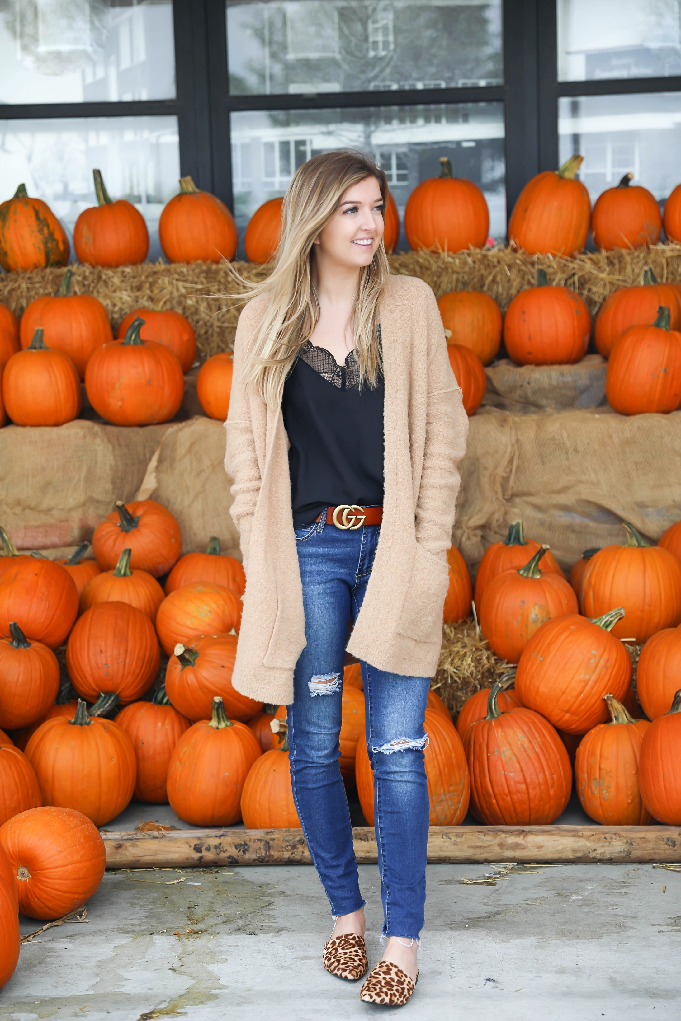Fall outfit for the pumpkin patch! The cutest brown gucci belt and free people cardigan paired with a lace cami and leopard flats! Details on fashion blog daily dose of charm by lauren lindmark