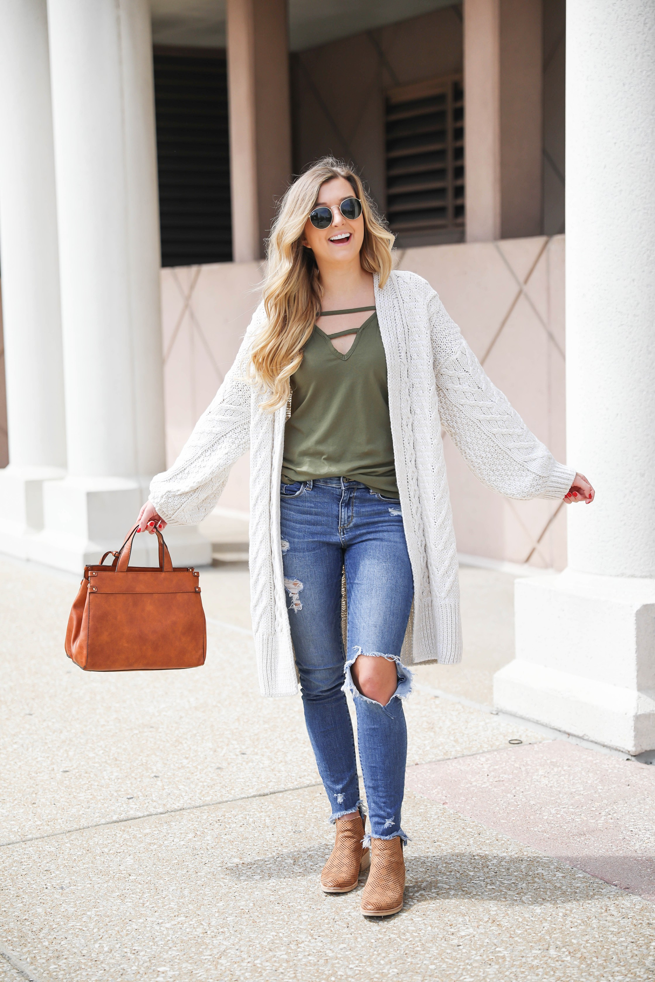Long cream knit cardigan with a fun olive tank! Paired with my favorite ripped jeans and this super cute faux leather sole society bag that's perfect for fall! These are also the best booties for fall! Details on fashion blog daily dose of charm by Lauren Lindmark