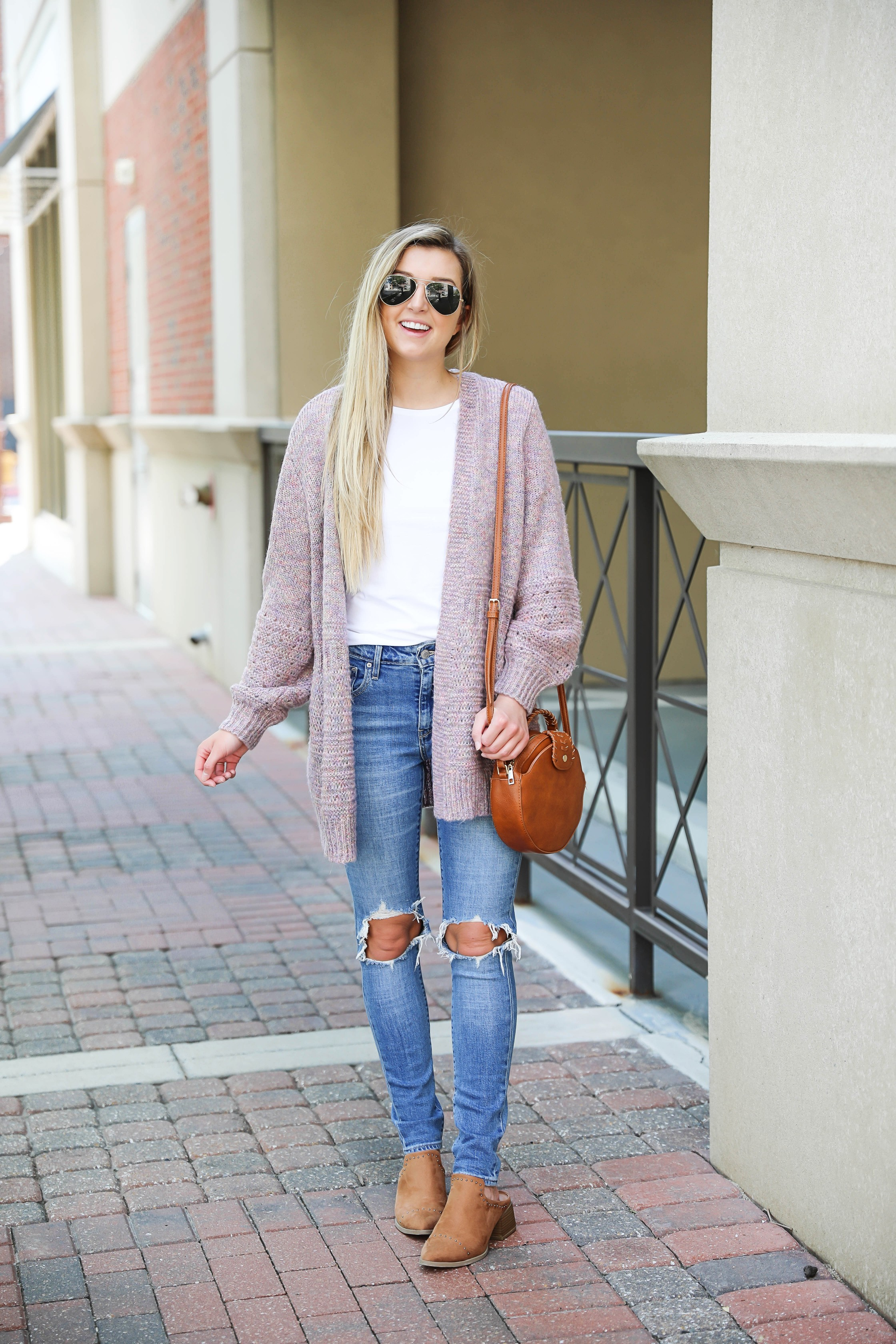 Pink knit cardigan with ripped denim jeans! I paired this look with the cutest pointed toe bootie slides from target! I love Target style, their shoes are so cute! Details on this fall outfit on fashion blog daily dose of charm by lauren lindmark