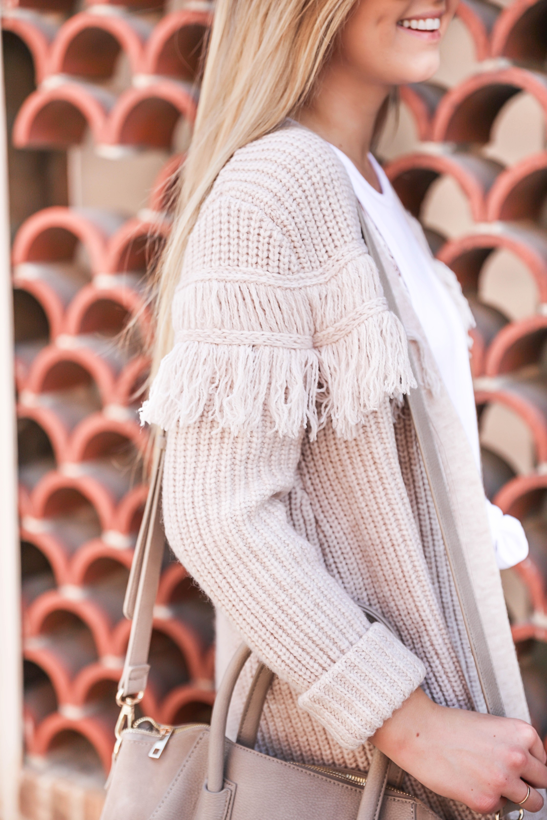 """Statement shoes for fall from Stage Stores! I can't stop buying shoes for this season, I am sharing this super cute all white look with these adorable Sam Edelman soludos flats that say """"queen bee!"""" Details on fashion blog daily dose of charm by lauren lindmark"""