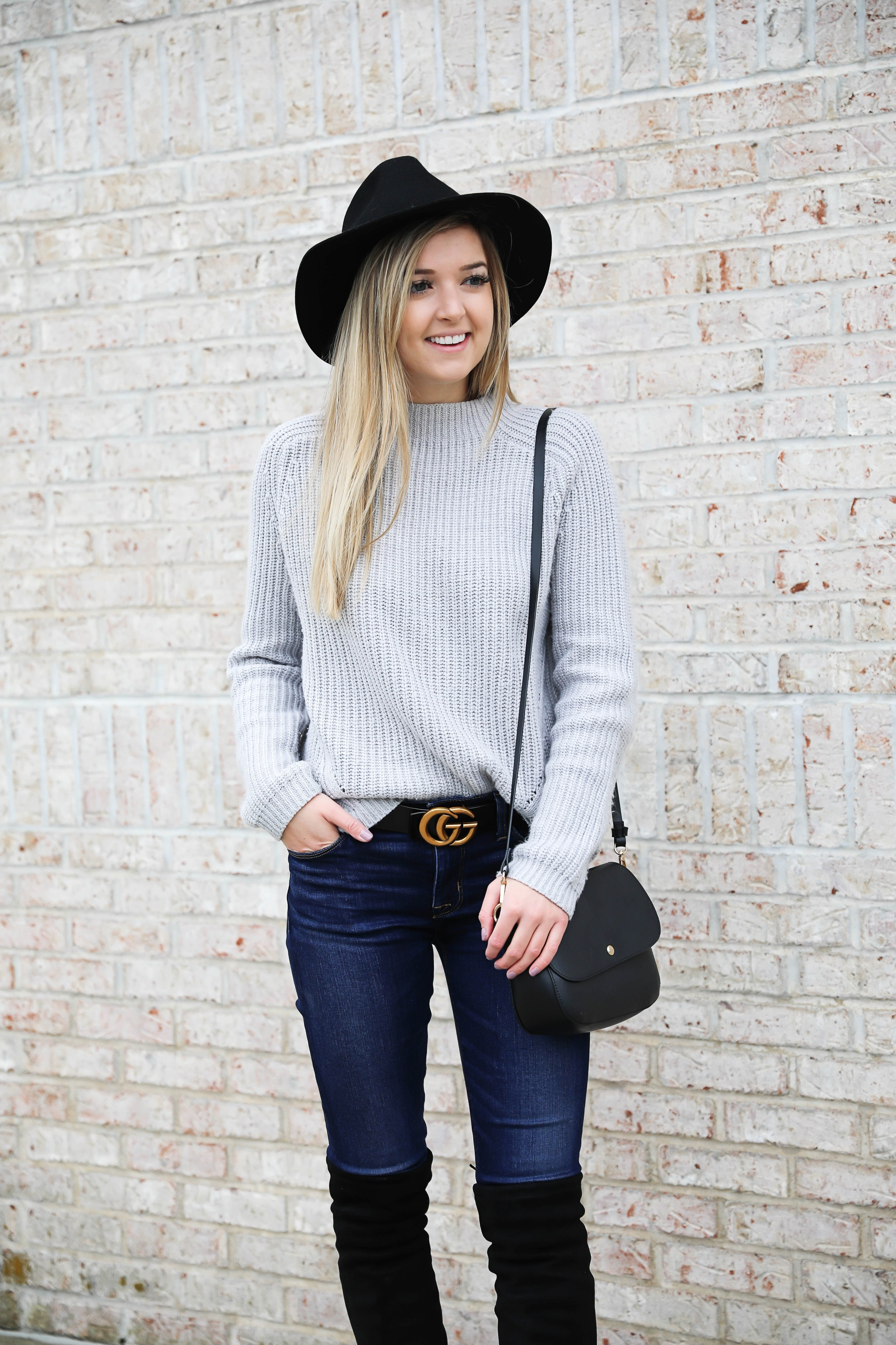 Gray sweater paired with dark denim and this super cute $30 gucci belt! I love these black over the knee boots and my felt hat for fall! Get outfit details on daily dose of charm by lauren lindmark