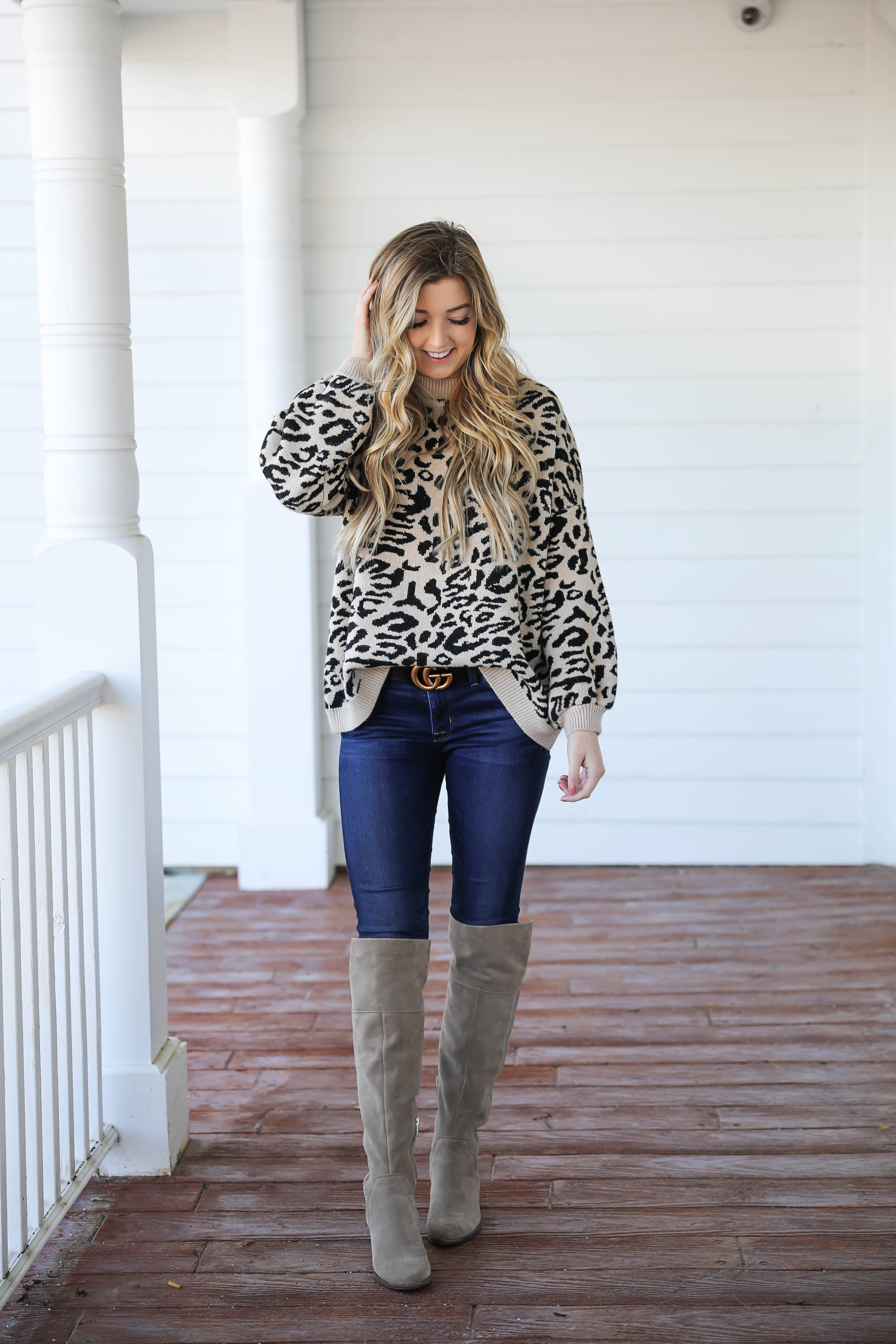 Leopard sweater for fall! Paired with my favorite $30 Gucci belt and Vince Camuto over the knee boots! Such a cute fall outfit idea! Details on fashion blog daily dose of charm by Lauren Lindmark