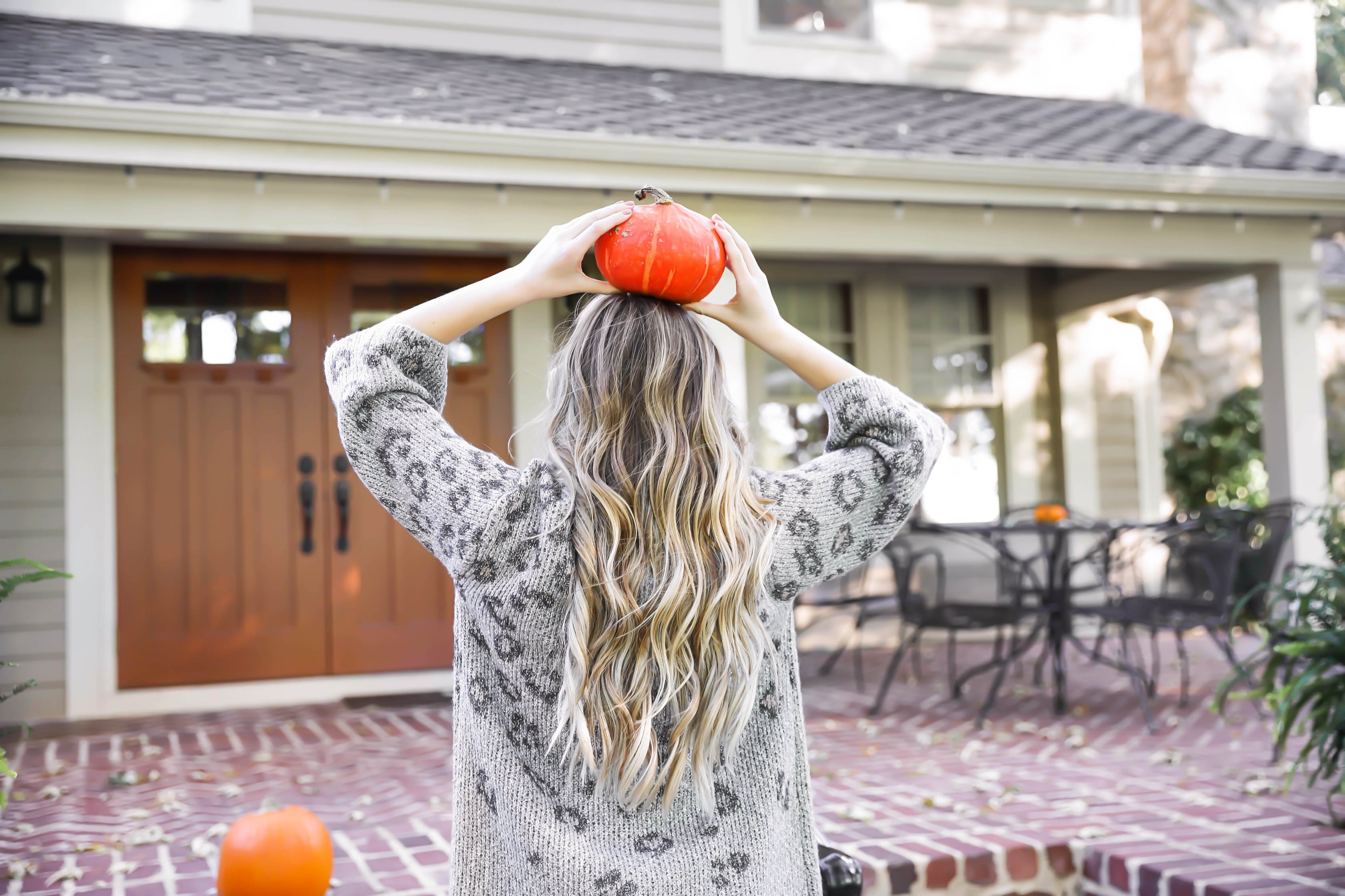 Natural beaded row extensions! The best stylist for NBR extensions in Kansas City is Traci Morby! Fall outfit idea! Sitting on a porch of pumpkins wearing my favorite leopard cardigan! Details on fashion blog daily dose of charm by lauren lindmark