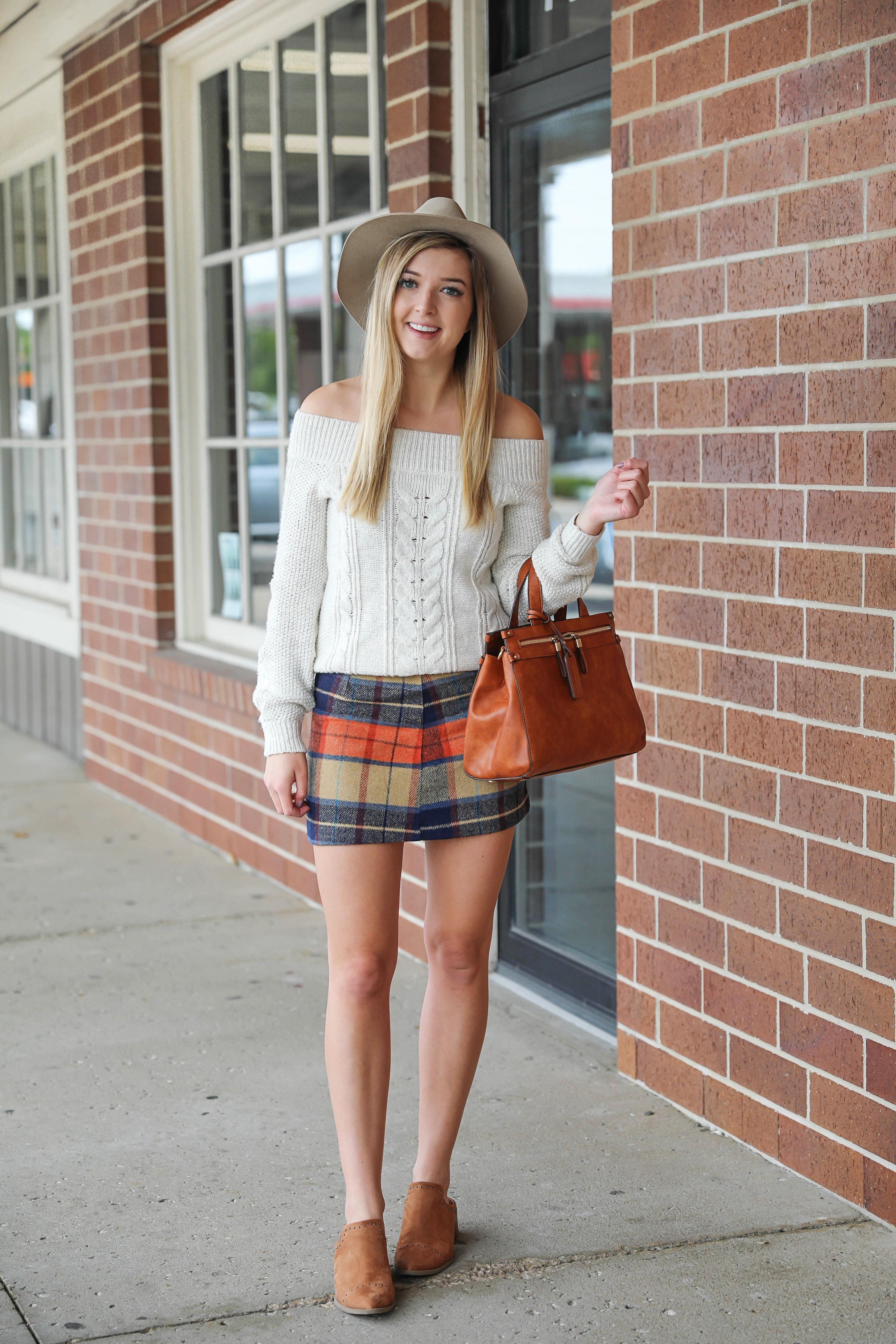 Plaid skirt with a cute cream knit off the shoulder sweater! The cutest fall outfit with a fun faux leather bag! Cute Abercrombie and Fitch and Lulu's fashion! Details on fashion blog daily dose of charm by Lauren Lindmark