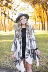 Plaid poncho wrapped around a tight black body con dress! I love these wraps for fall because they can double as scarves! This dress is by Leith from nordstrom and I am obsessed! Details on this fall fashion look and fall trees photoshoot can be found on fashion blog daily dose of charm by lauren lindmark