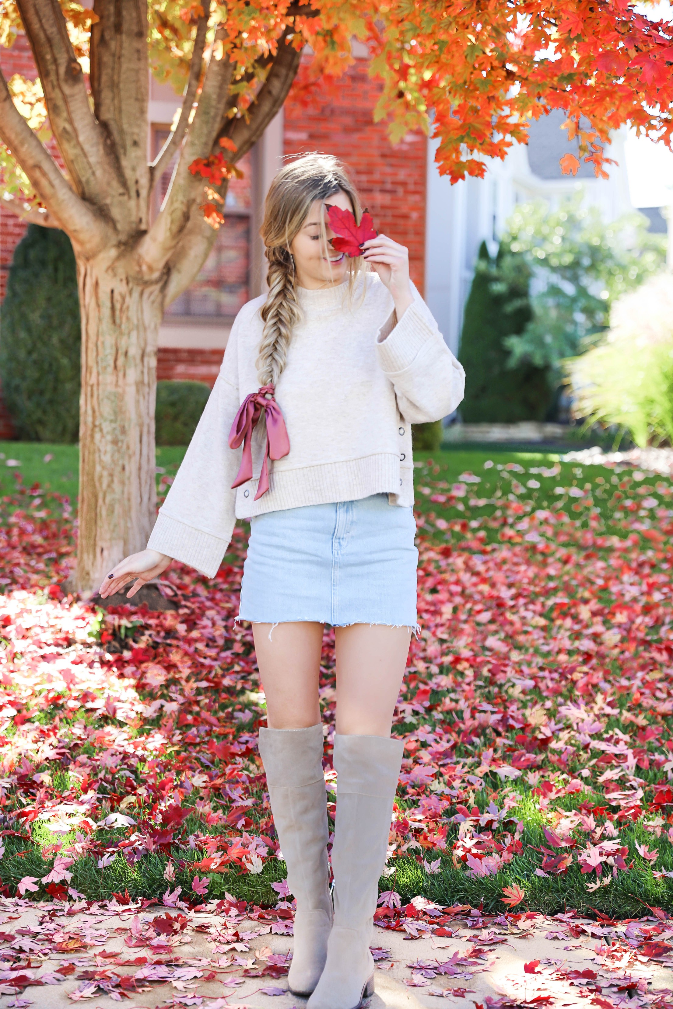 Two ways to style jean skirts in the fall! Jean skirt paired with a cute cardigan and jean skirt paired with a cropped sweater! Details on fashion blog daily dose of charm by lauren lindmark