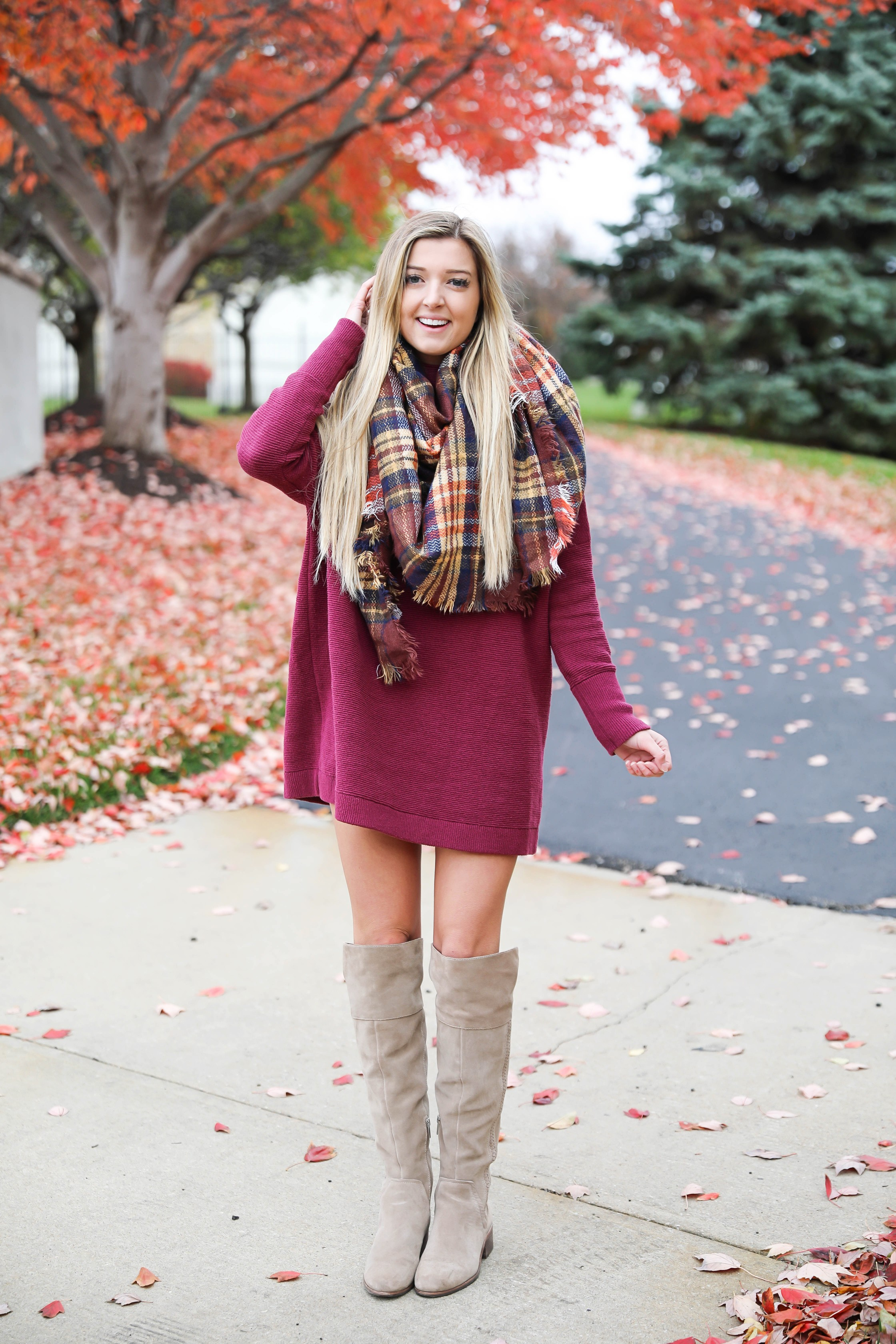 Burgundy sweater dress paired with a cute plaid scarf! Such a cute thanksgiving outfit! This cute fall dress is by free people and this plaid scarf look so cute with it! I paired it with my suede vince camuto over the knee boots! Details on fashion blog daily dose of charm by lauren lindmark