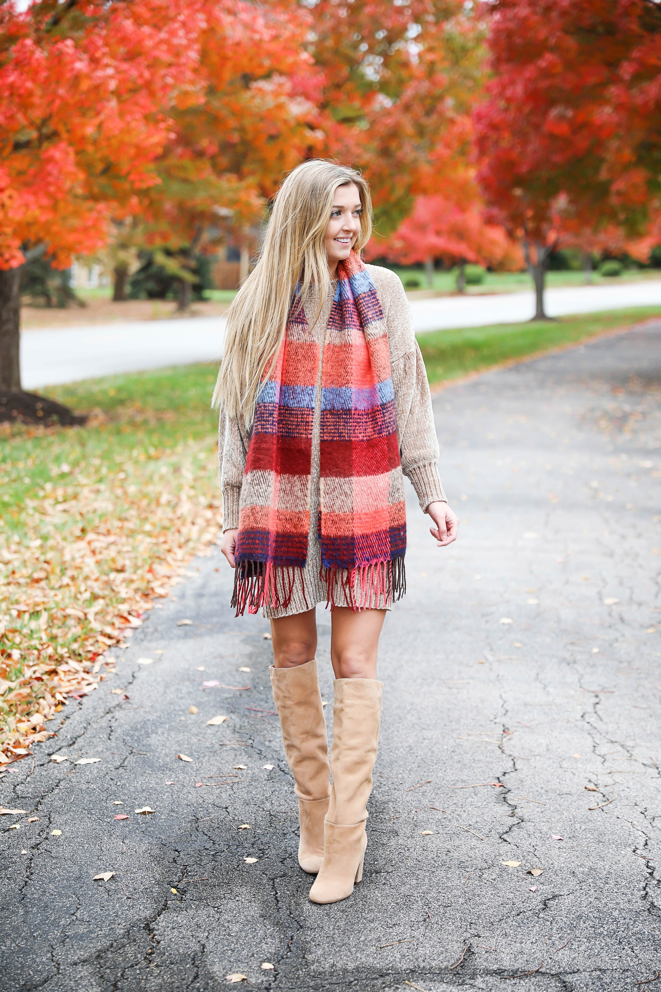 Chenille sweater dress form Red Dress Boutique! I love sweater dresses and chenille is my favorite trend for fall 2018! I paired it with this cute plaid scarf and my favorite tan boots! Nothing like a cute fall outfit in front of beautiful red autumn leaves on the trees! Details on fashion blog daily dose of charm by lauren lindmark
