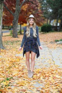 Gray long sleeve flattering dress with a cute flannel tied around the waist! These photos were taken in the prettiest fall leaves! I paired the outfit with this cute felt hat and suede booties! Details on fashion blog daily dose of charm by lauren lindmark