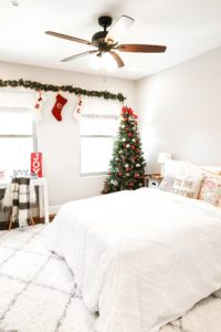 Holiday room decor! Decorate my apartment for Christmas with me! I blogged my adorable white, red, and green christmas tree! I also hung up some cute, inexpensive garland! Cutest white room decorations! Get all the details on fashion blog daily dose of charm by lauren lindmark