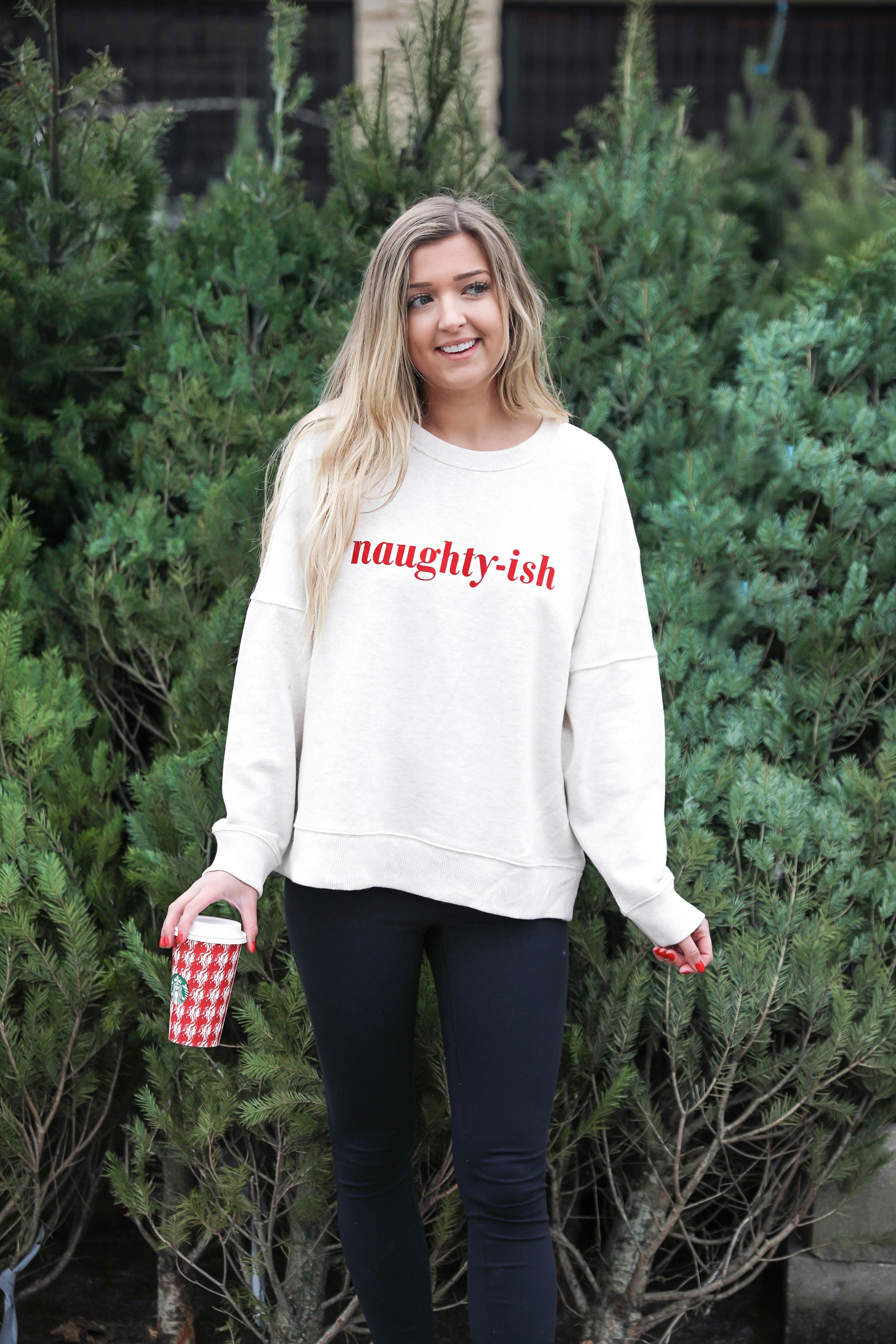 Naughtish and Niceish sweatshirt for the holidays! I love all the funny naught and nice holiday outfits going around right now! This sweatshirt is so comfortable! It would be a cute christmas and funny ugly christmas sweater! Such a fun casual winter outfit! Details from kansas city fashion blog daily dose of charm by lauren lindmark