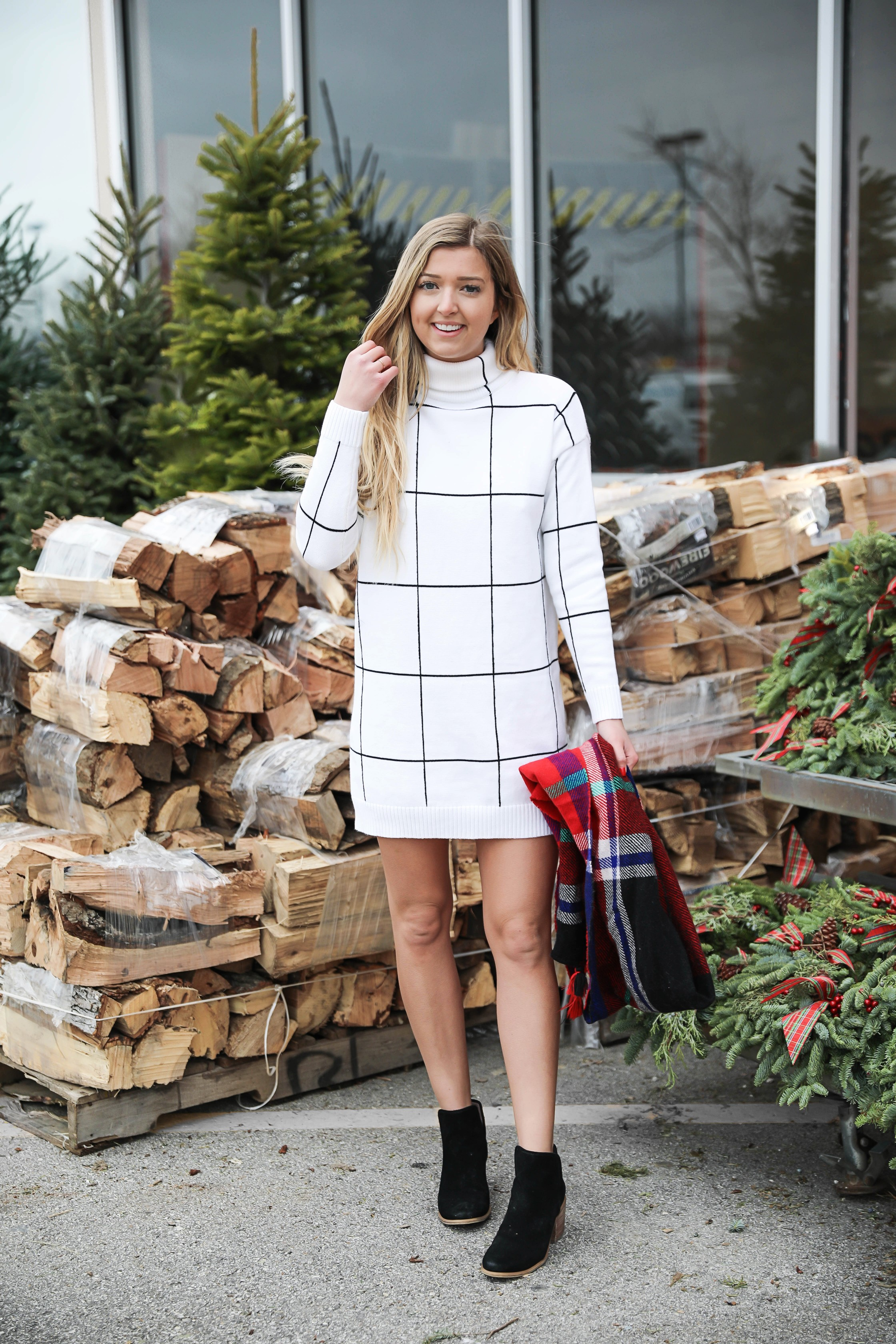 The cutest black and white window pane dress from chicwish! I paired it with my favorite jcrew red plaid scarf and my black hinge booties from Nordstrom BP! Details on this winter outfit on fashion blog daily dose of charm by lauren lindmark