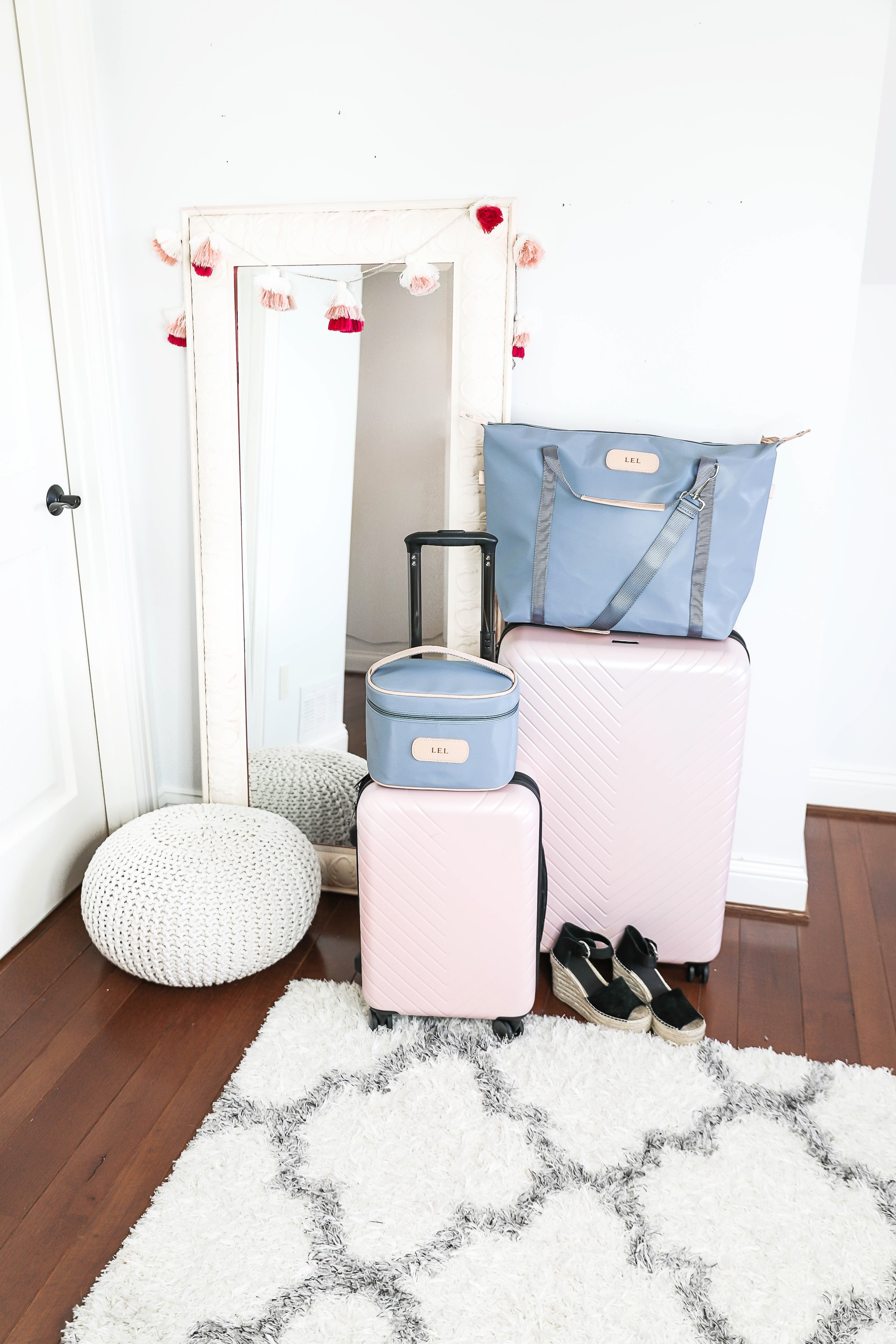 Packing tips for a trip from the queen of overpacking! I use the cutest Nordstrom suitcase and Jon Hart luggage for my trips! Spring break packing with the latest spring trends! How cute are these ugg sneakers, Marc Fisher wedges? Details on fashion blog daily dose of charm by lauren lindmark