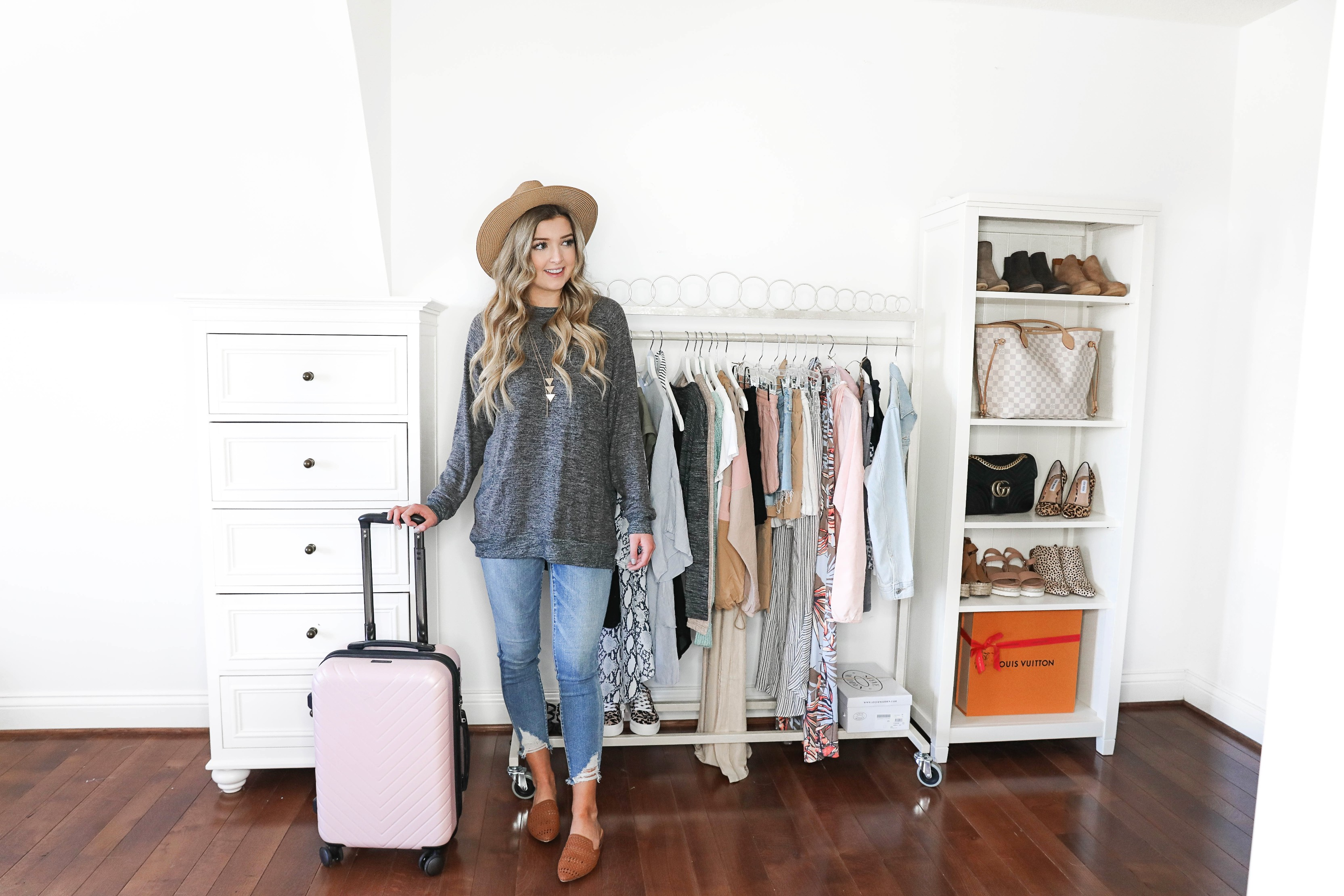 How I plan my outfits for trips and blog photos! Total closet and wardrobe goals! I love my new garment rack right next to my shoe rack and fashion shelves! All the travel packing planning tips you need! Details on fashion blog daily dose of charm by lauren lindmark
