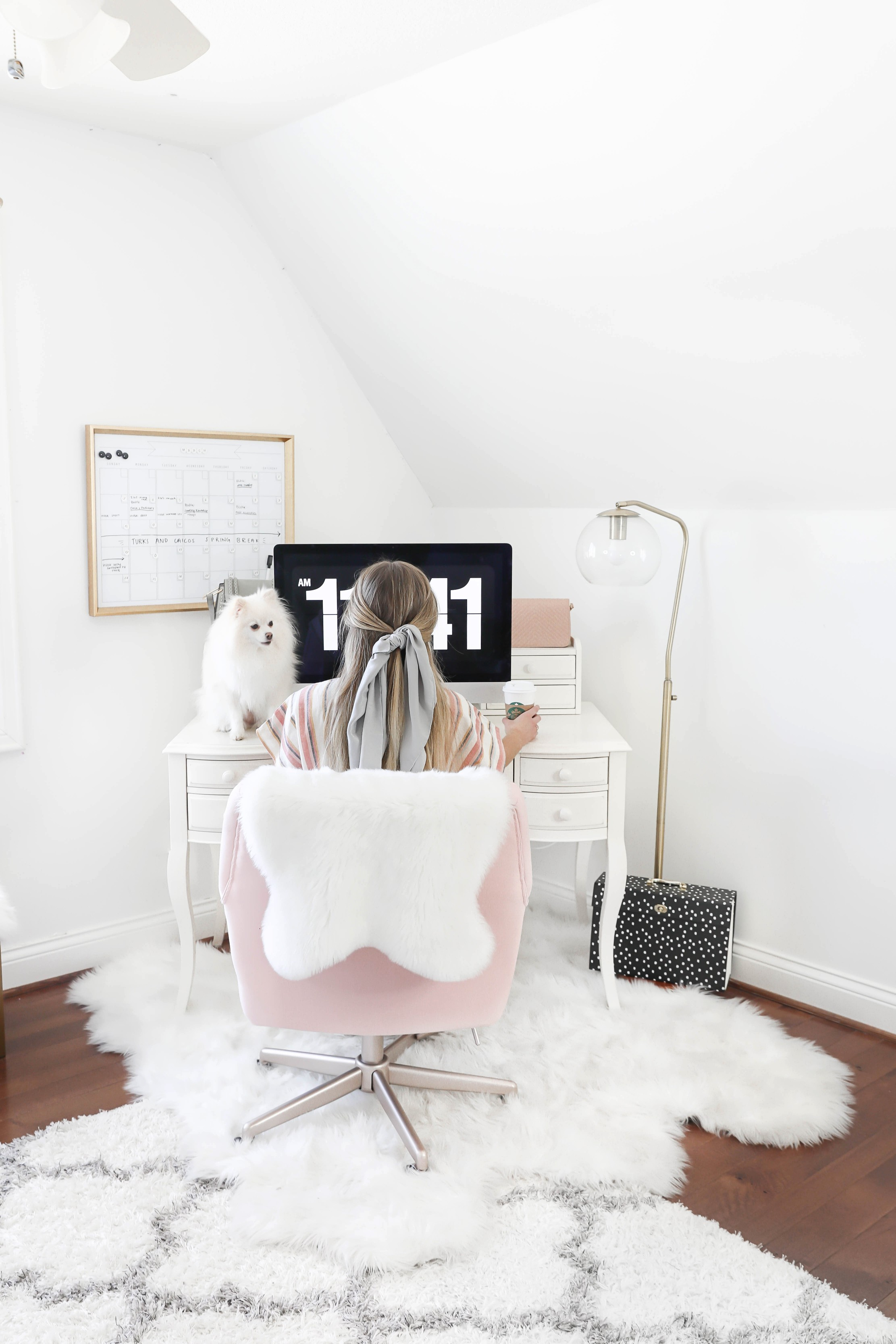 Office tour! Ultimate desk goals for the girl boss! I love this super comfy pink desk chair! I had been looking for a new chair and found the perfect one! The space looks so cute with my faux sheep fuzzy rug, and all the white, black, gold and pink. This is also the cutest gold dry erase calendar! Details on fashion and lifestyle blog daily dose of charm by lauren lindmark