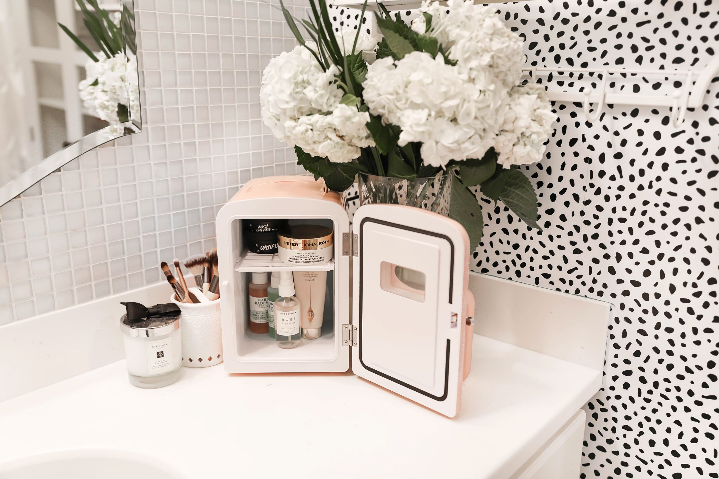Beauty favorites spring 2019! I love my frigidaire mini retro beauty fridge! I stocked it with amazing face mask and lush products! Details on beauty and fashion blog daily dose of charm by lauren lindmark