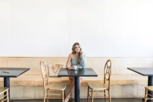 Best Kansas City Coffee shops! Cute restaurant photoshoot wearing an off the shoulder sweater! Details on fashion blog daily dose of charm by lauren lindmark