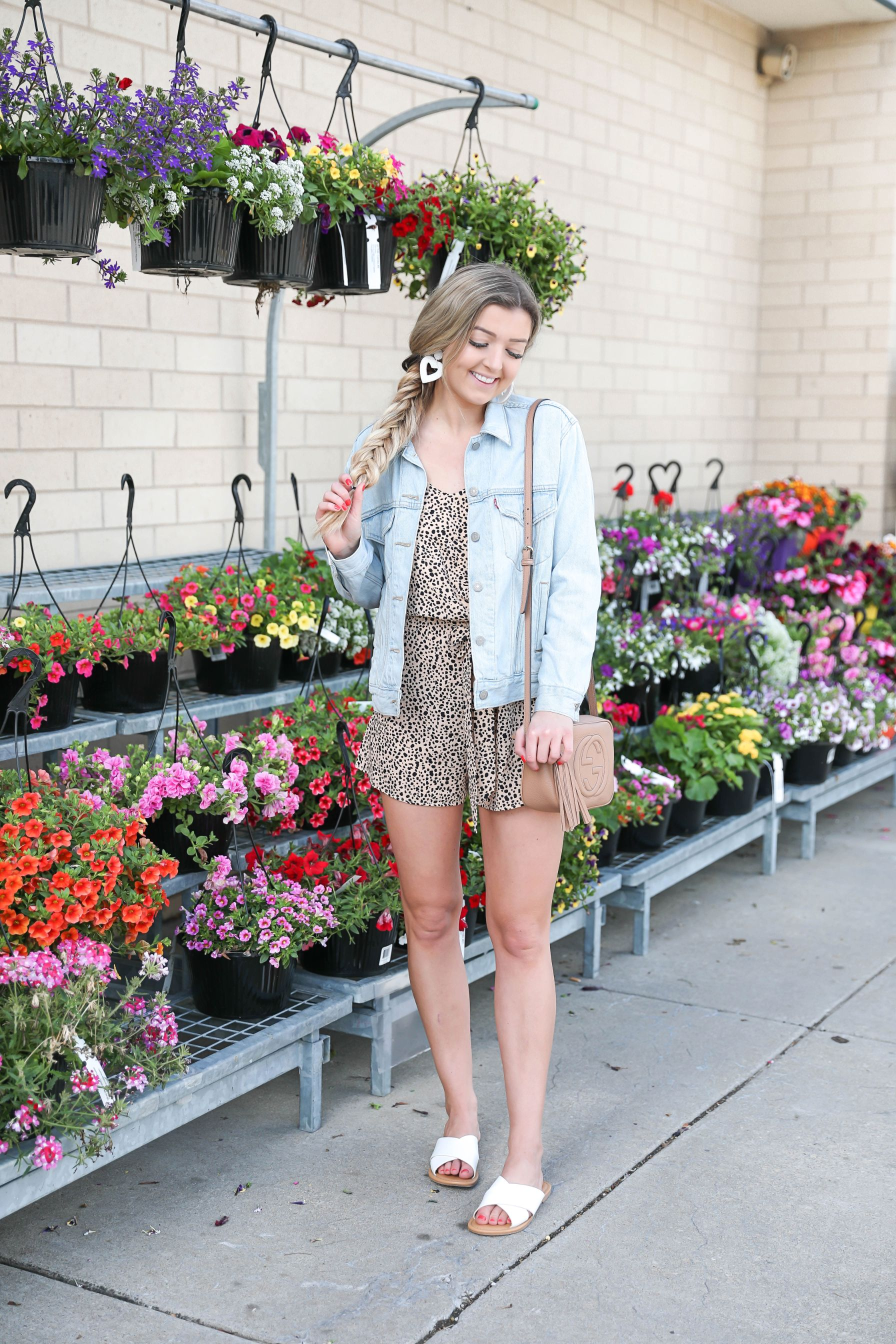 "Closet Candy leopard romper! This cute ""here comes trouble"" romper is so perfect for spring and summer! I paired it with the cutest denim jean jacket and heart earrings! All details on this outfit can be found on fashion blog daily dose of charm by lauren lindmark"