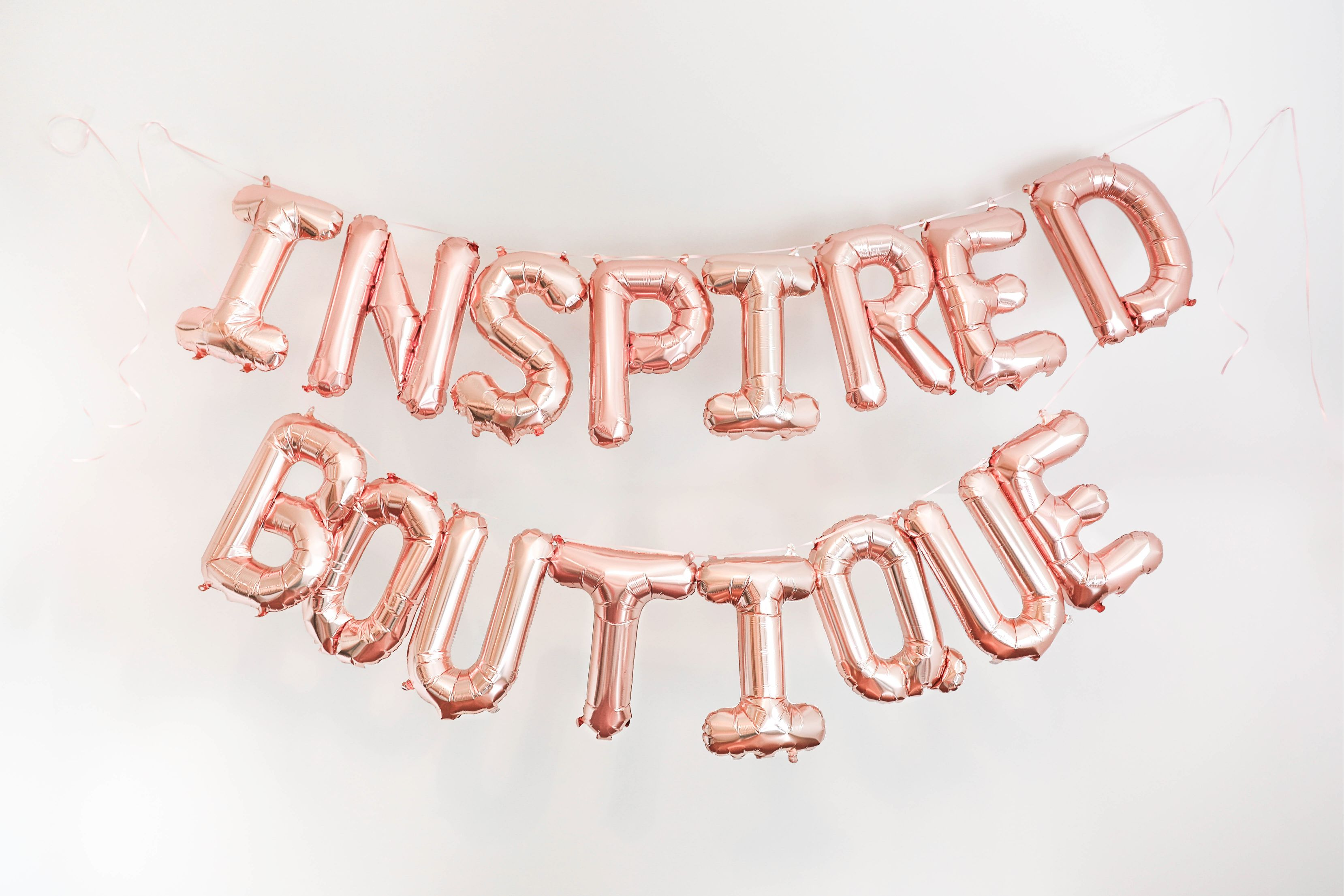 Inspired boutique daily dose of charm lauren lindmark name reveal balloons photoshoot new store ecommerce